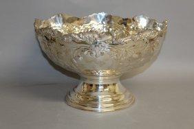 905. A Large Circular Pedestal Punch Bowl, Repousse
