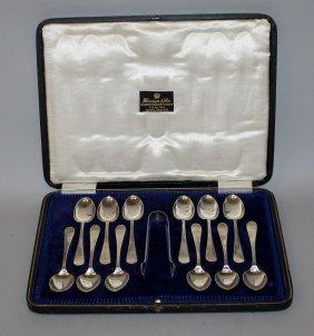 911. A Set Of Twelve Teaspoons And Pair Of Sugar