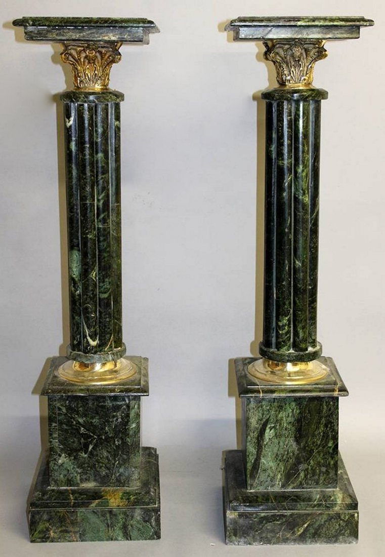 A PAIR OF GREEN MARBLE PEDESTALS with cluster columns