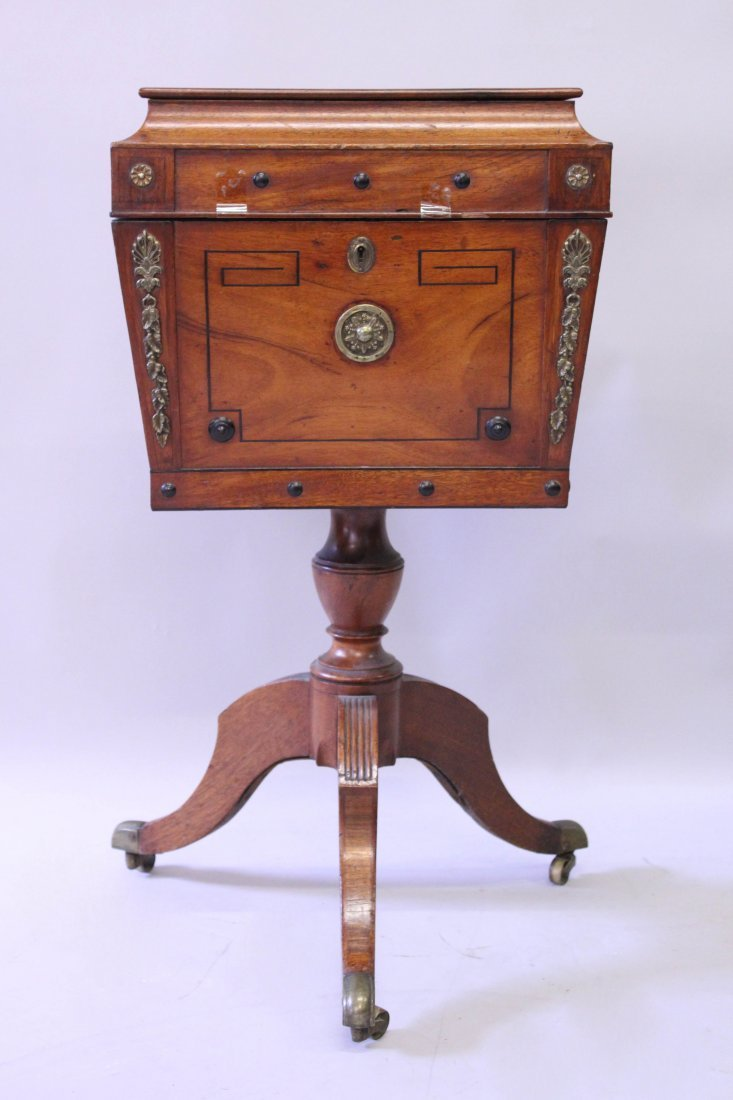A REGENCY ROSEWOOD TEAPOY with rising top and fitted