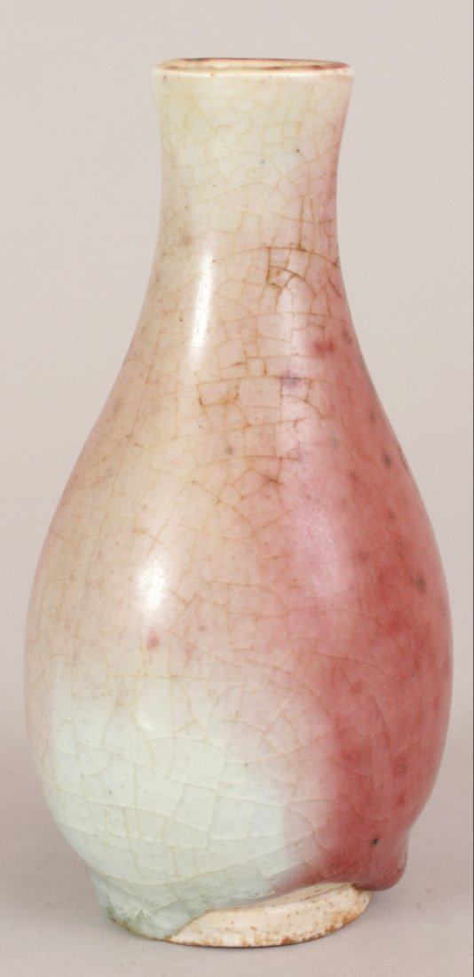 AN UNUSUAL CHINESE PEACH BLOOM PORCELAIN VASE,