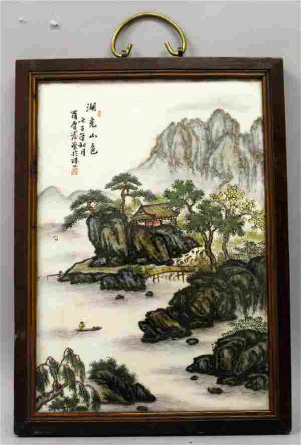 A CHINESE WOOD FRAMED PORCELAIN PLAQUE, decorated with