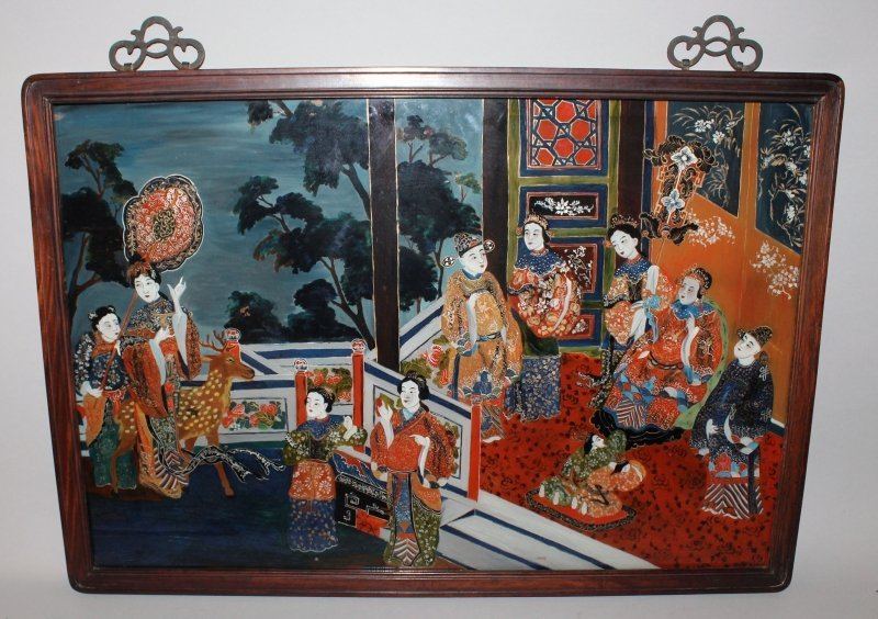 A 20TH CENTURY CHINESE REVERSE GLASS PAINTING, in a
