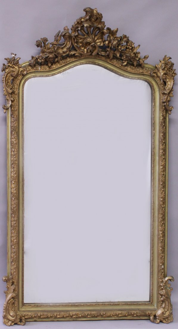 A 19TH CENTURY GILT FRAMED MIRROR, with curving top and