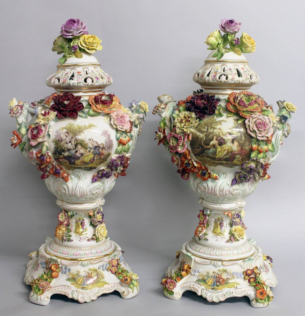 "A LARGE PAIR OF ""DRESDEN"" STYLE FLOWER ENCRUSTED URNS,"