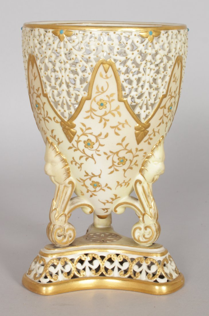 A GRAINGER & CO ROYAL WORCESTER PIERCED URN with gilt