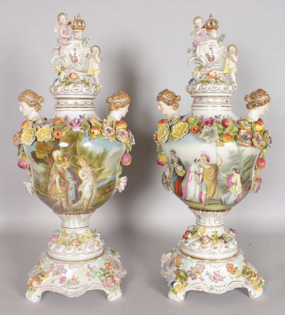 "A LARGE PAIR OF ""DRESDEN"" STYLE TWO HANDLED URNS,"