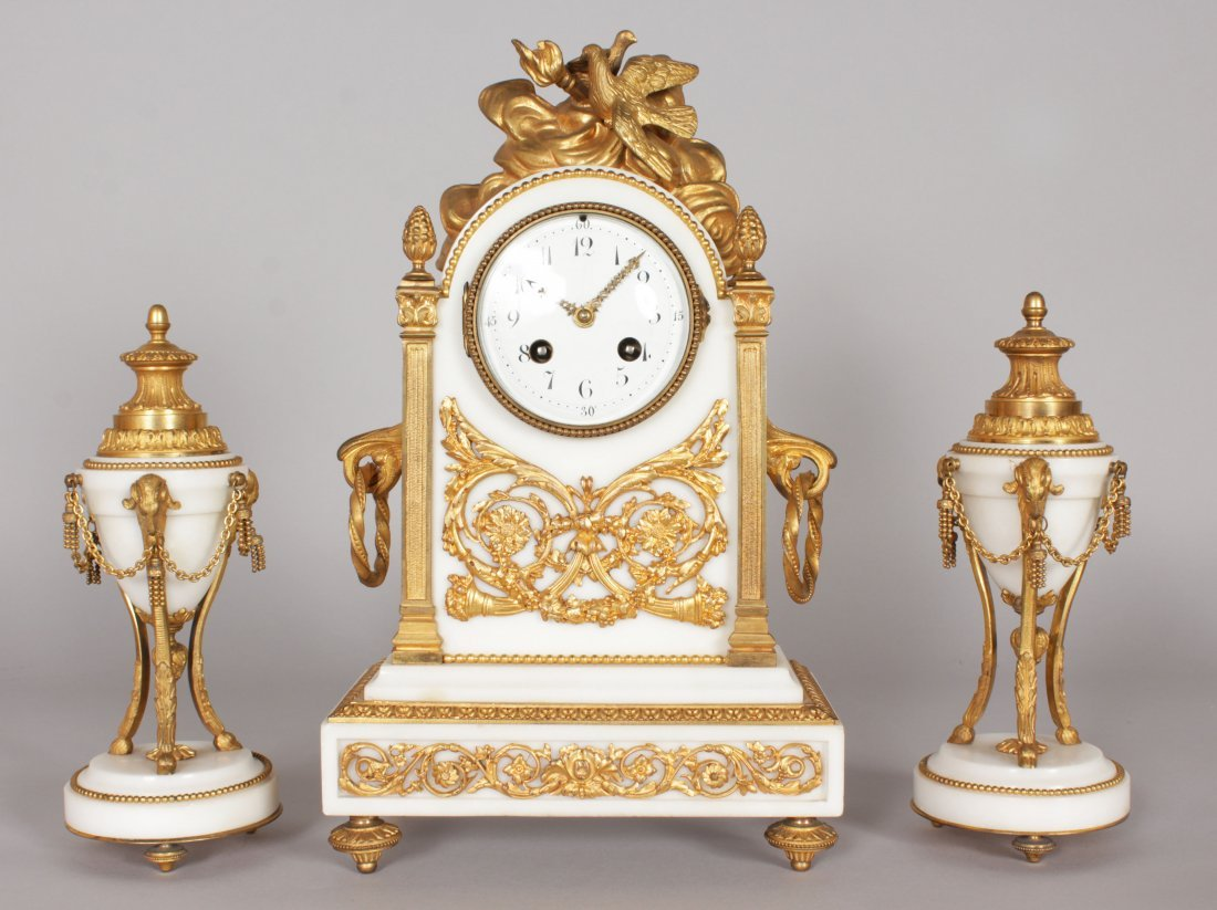 A GOOD FRENCH WHITE MARBLE AND ORMOLU THREE PIECE CLOCK