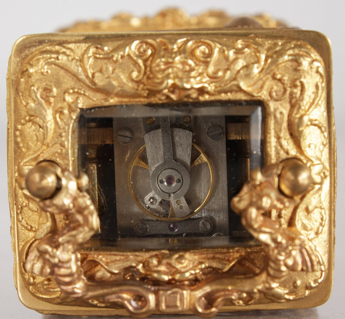 A MINIATURE BRASS CARRIAGE CLOCK with caryatid figures. - 3