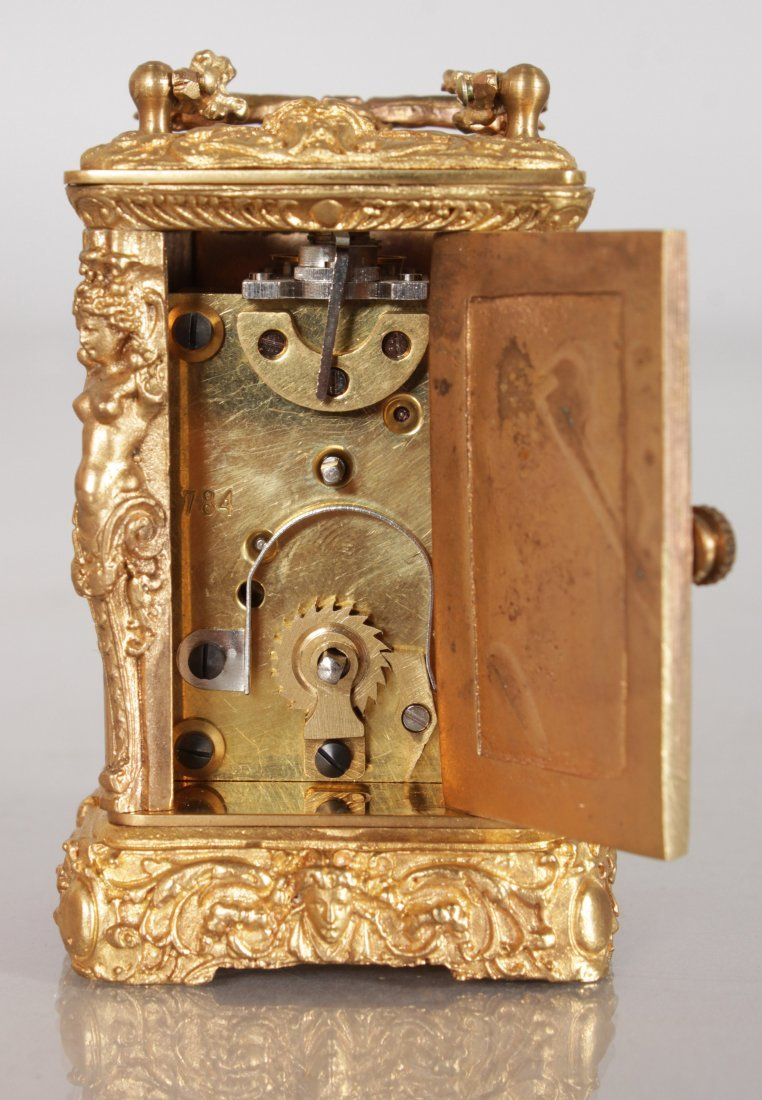A MINIATURE BRASS CARRIAGE CLOCK with caryatid figures. - 4
