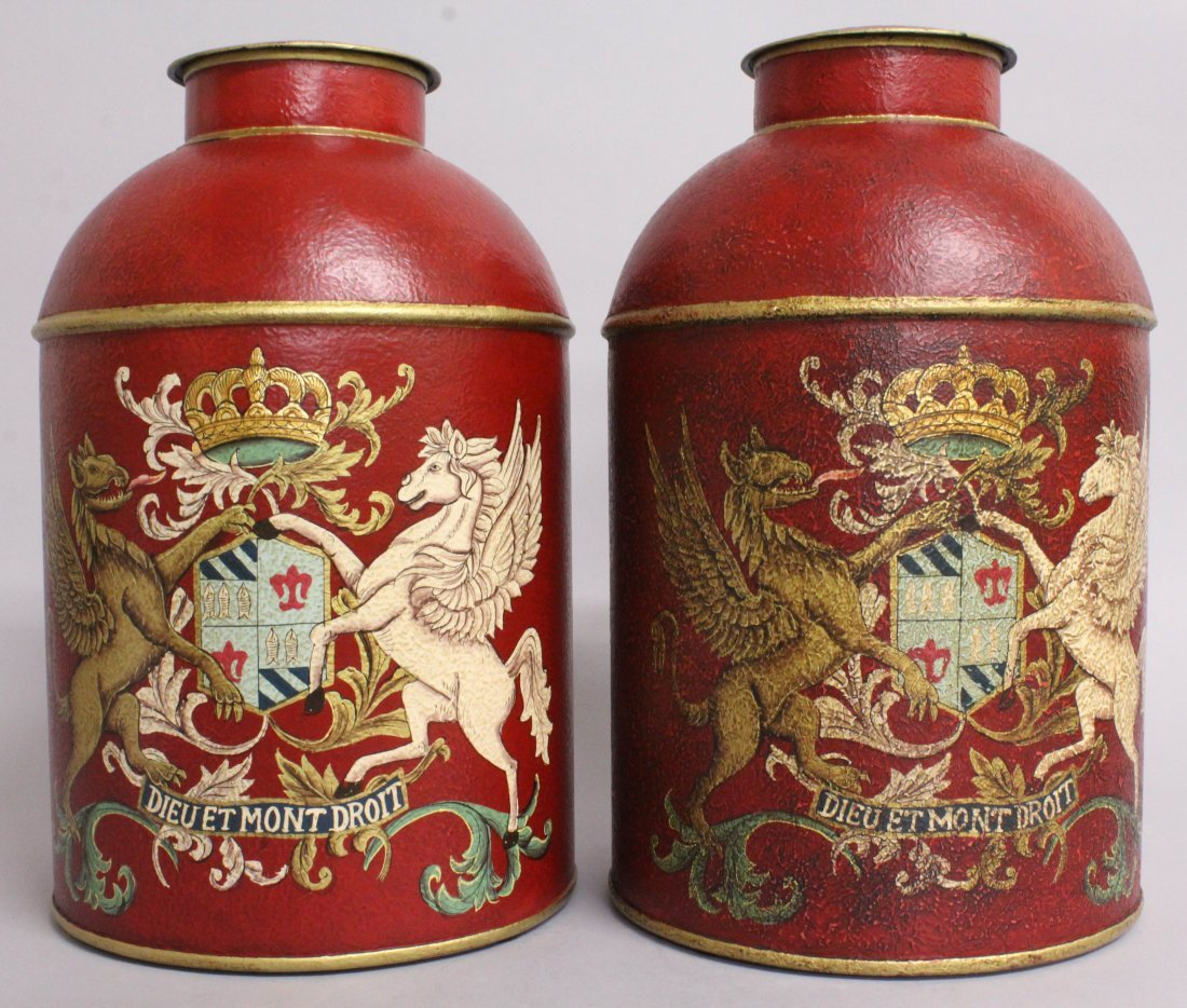 A PAIR OF RED TOLEWARE TINS AND COVERS, decorated with
