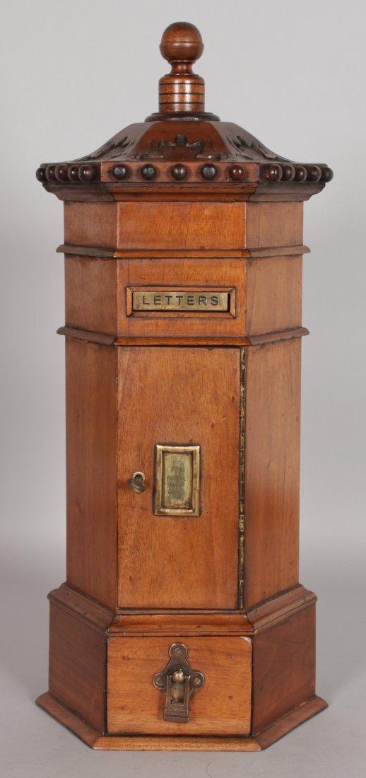 A VICTORIAN STYLE MAHOGANY HEXAGONAL SHAPED PILLAR BOX,