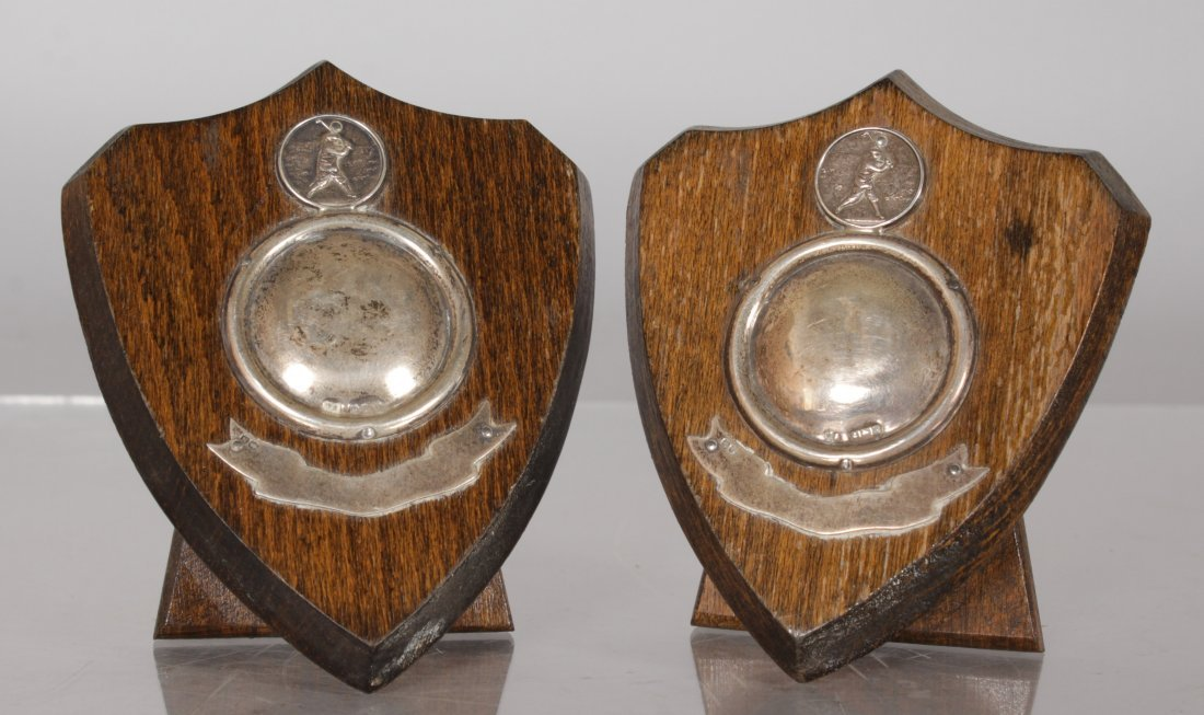 A PAIR OF WOODEN SHIELD SHAPED SILVER MOUNT GOLF
