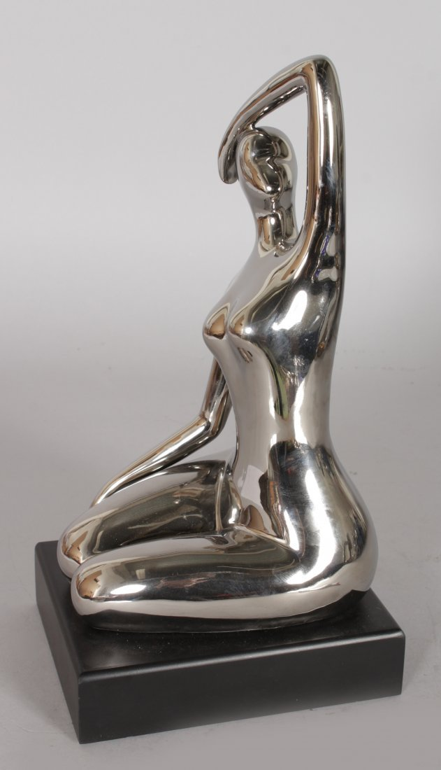 A SILVERED MODEL OF A KNEELING LADY.  10ins high. - 2