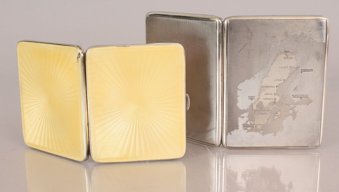 TWO SILVER CIGARETTE CASES.
