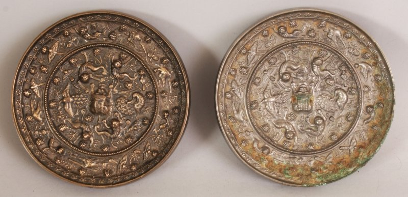 A PAIR OF CHINESE TANG STYLE SILVERED BRONZE CIRCULAR