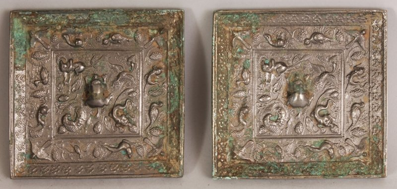 A SMALLER PAIR OF CHINESE TANG STYLE SILVERED BRONZE