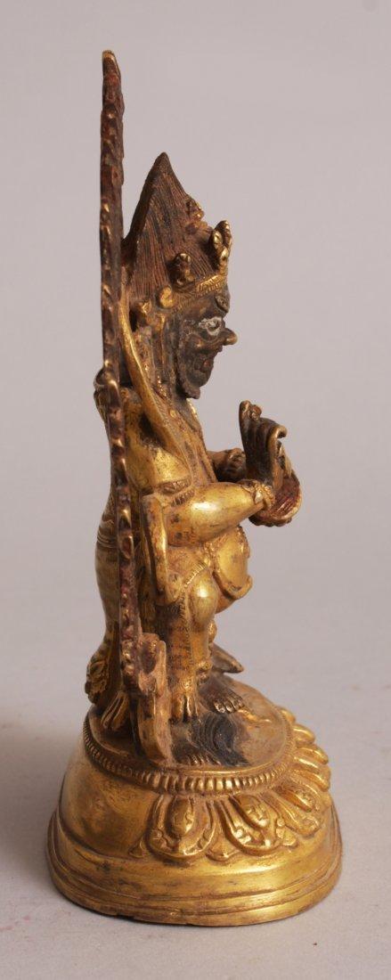 A SINO-TIBETAN GILT BRONZE FIGURE OF MAHAKALA, seated - 2
