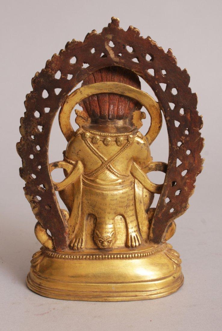 A SINO-TIBETAN GILT BRONZE FIGURE OF MAHAKALA, seated - 3