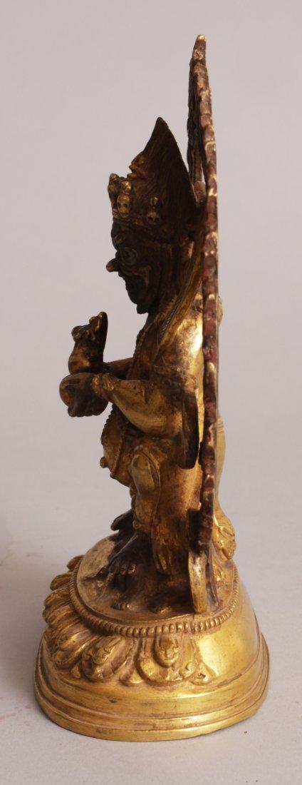 A SINO-TIBETAN GILT BRONZE FIGURE OF MAHAKALA, seated - 4