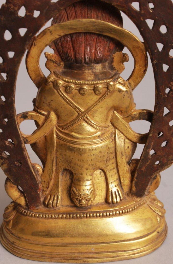 A SINO-TIBETAN GILT BRONZE FIGURE OF MAHAKALA, seated - 8