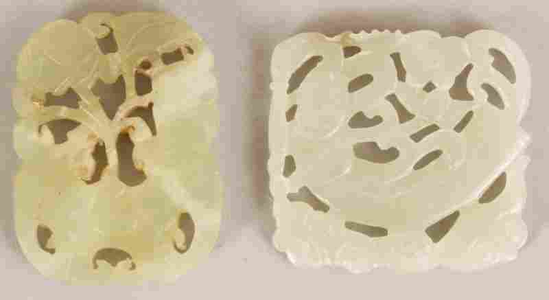 TWO CHINESE PIERCED CELADON GREEN JADE LIKE HARDSTONE