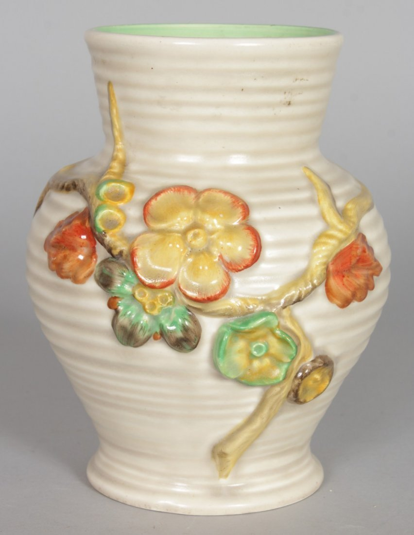 A CLARICE CLIFF VASE, of baluster form, relief