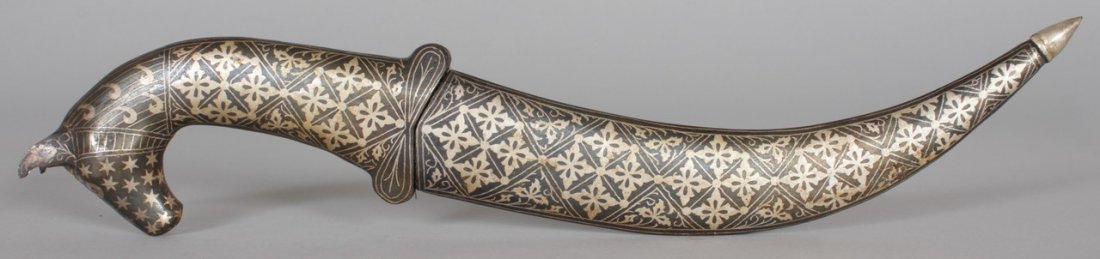 AN EASTERN DAGGER, with silver inlaid decoration and