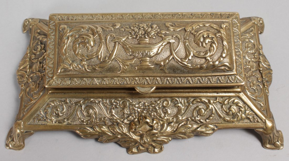 A BRASS STAMP BOX with five divisions.  8ins long. - 2