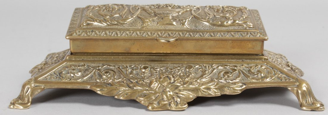 A BRASS STAMP BOX with five divisions.  8ins long. - 3
