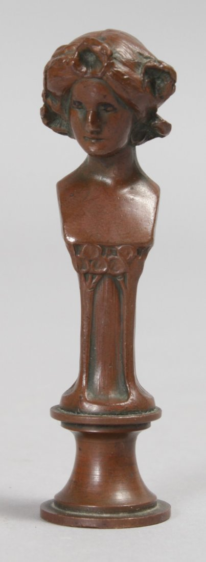 A SMALL ART NOUVEAU BRONZE SEAL.  2.75ins high.