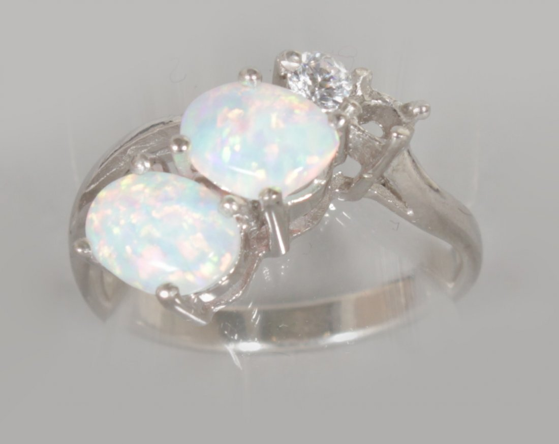 A GILSON OPAL AND BRILLIANT SET SILVER RING.