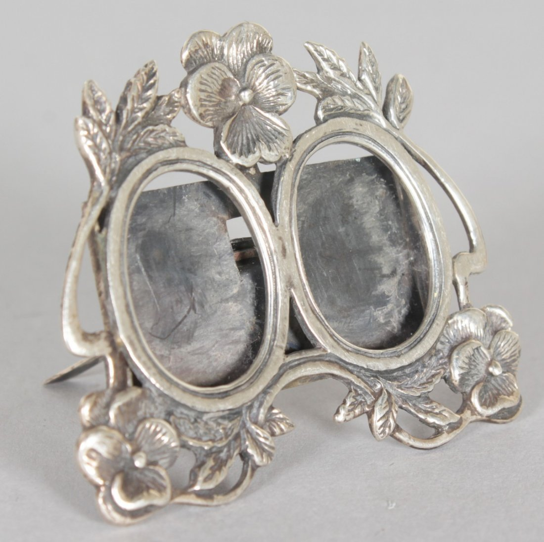 A MINIATURE SILVER DOUBLE FRAME.