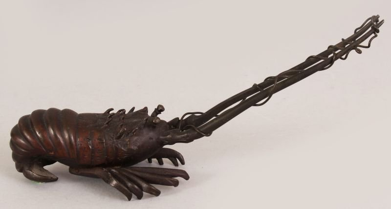 A 19TH/20TH CENTURY JAPANESE BRONZE MODEL OF A