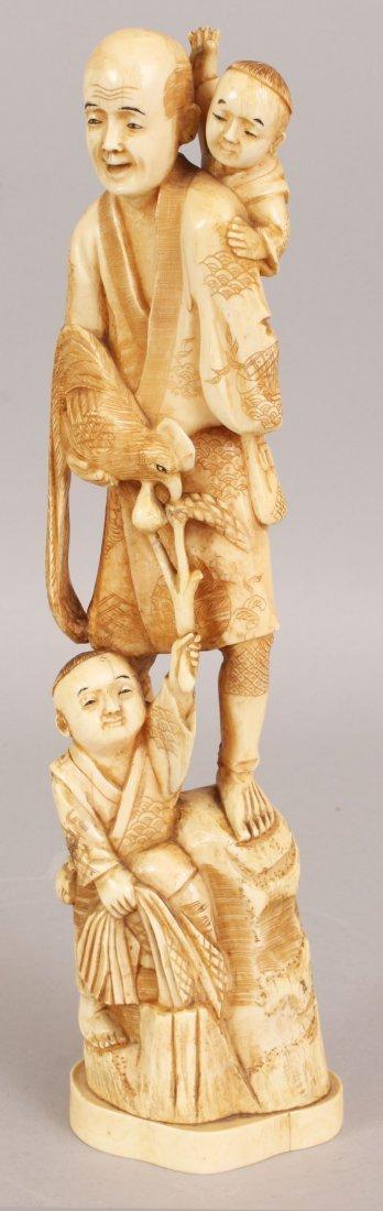 A SIGNED JAPANESE MEIJI PERIOD IVORY OKIMONO OF A