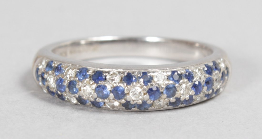 AN 18CT WHITE GOLD, DIAMOND AND SAPPHIRE HOOP RING.