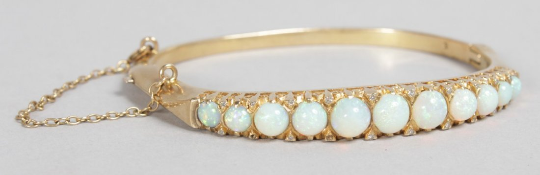 A GOOD YELLOW GOLD AND OPAL BRACELET set with eleven
