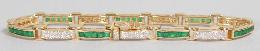 AN 18CT YELLOW GOLD, DIAMOND AND EMERALD LINE BRACELET.