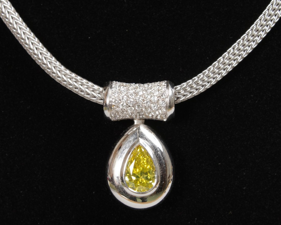 A SUPERB YELLOW DIAMOND TEARDROP PENDANT on an 18ct