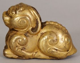 A SMALL CHINESE HAN STYLE GILT BRONZE MODEL OF A