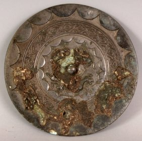 A CHINESE SILVERED BRONZE CIRCULAR MIRROR, possibly