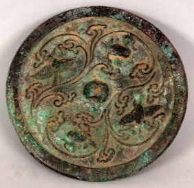 A SMALL CHINESE BRONZE MIRROR, possibly early,