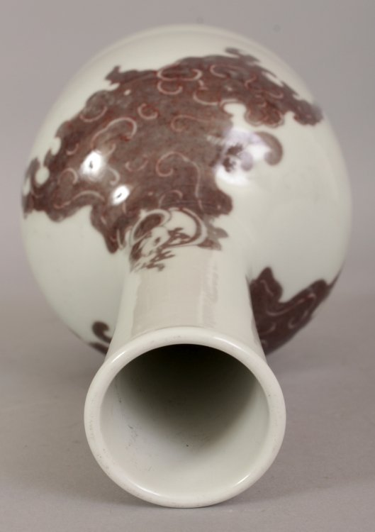 A CHINESE COPPER RED PORCELAIN BOTTLE VASE, the sides - 3