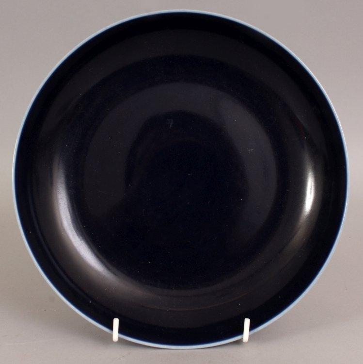 A CHINESE BLUE GLAZED PORCELAIN DISH, of saucer shape,