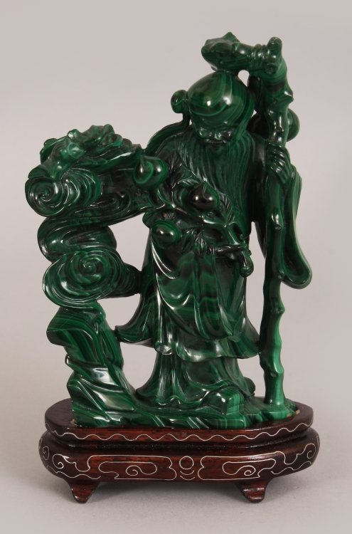 AN EARLY 20TH CENTURY CHINESE MALACHITE CARVING OF SHOU