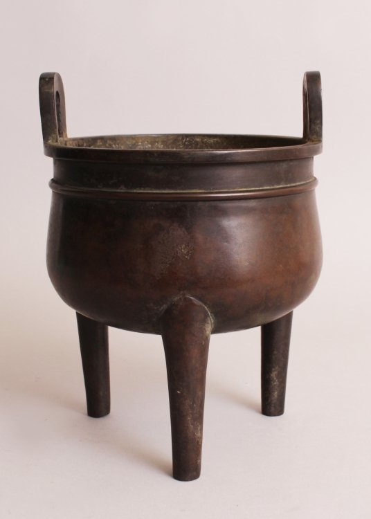 A CHINESE BRONZE TRIPOD CENSER, weighing 3.86Kg, with