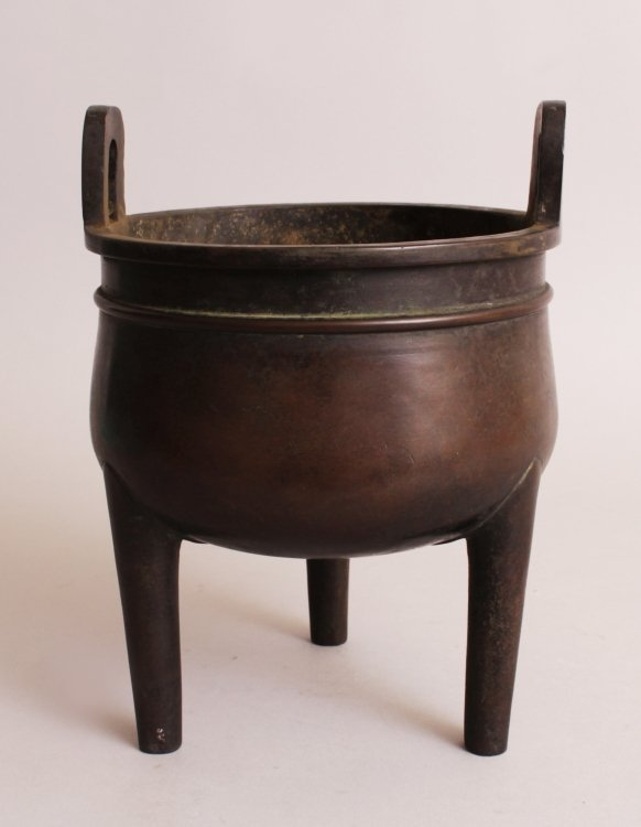A CHINESE BRONZE TRIPOD CENSER, weighing 3.86Kg, with - 4