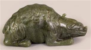 AN EARLY 20TH CENTURY CHINESE GREEN JADE CARVING OF A