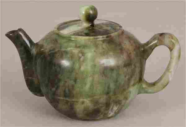 A CHINESE JADE LIKE HARDSTONE TEAPOT & COVER, the