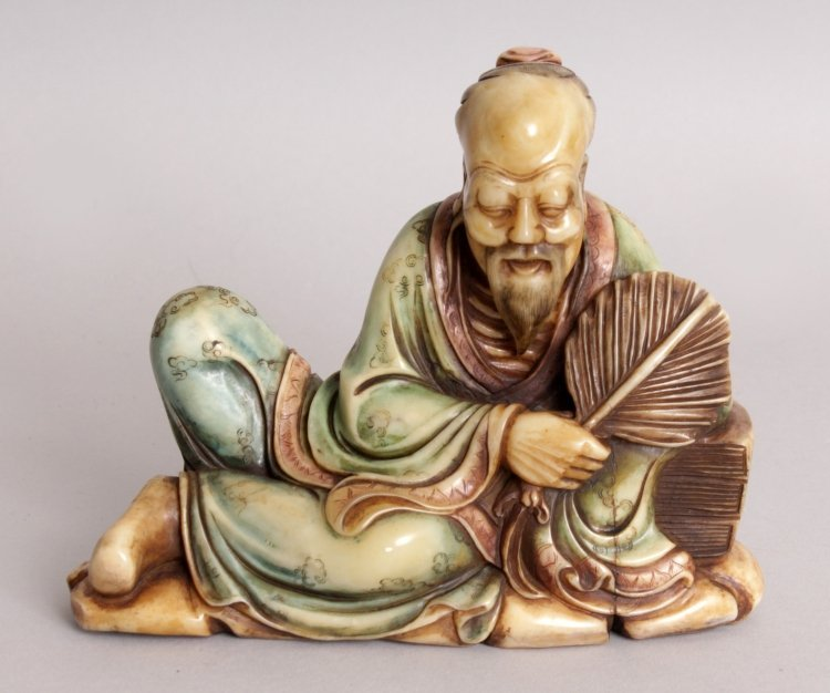 A GOOD QUALITY CHINESE STAINED SOAPSTONE CARVING OF A